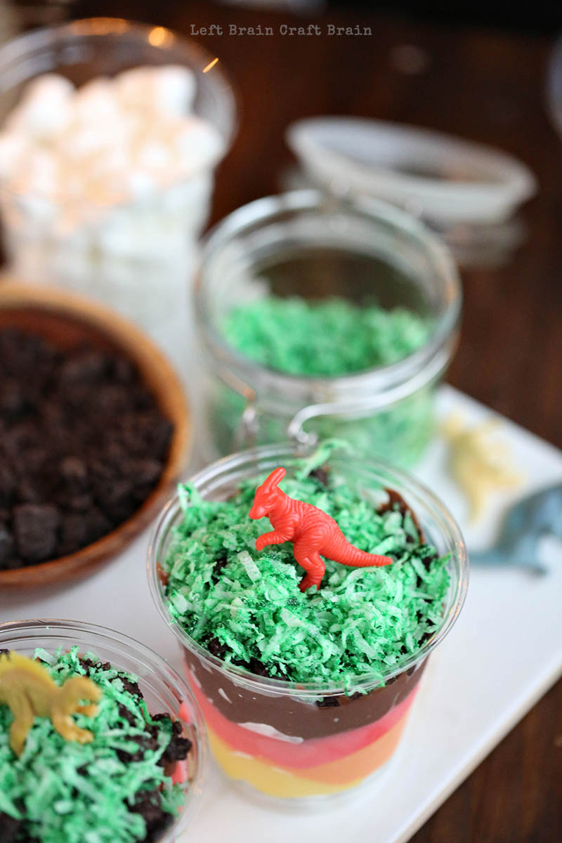 Kids can learn with every delicious bite of this Layers of the Earth Pudding Cup. These dinosaur topped treats make fun party desserts too. STEM made fun!