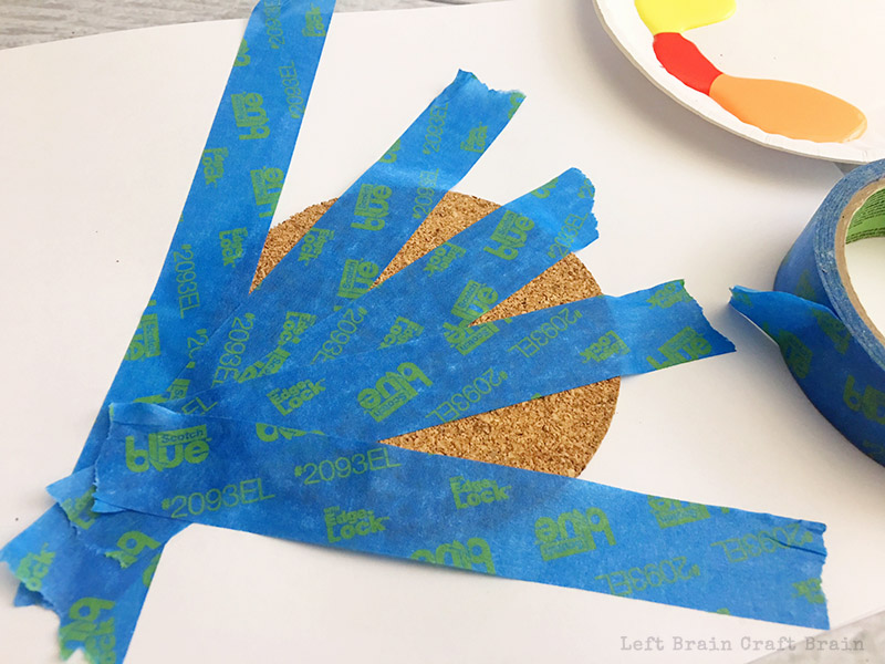 Use painters tape to create beautiful geometry art for your painted coasters.