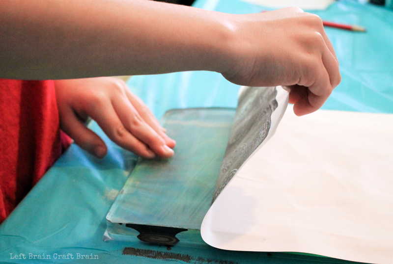 Carefully pull back your work from the gelli printing materials to create a screen printing like art work.