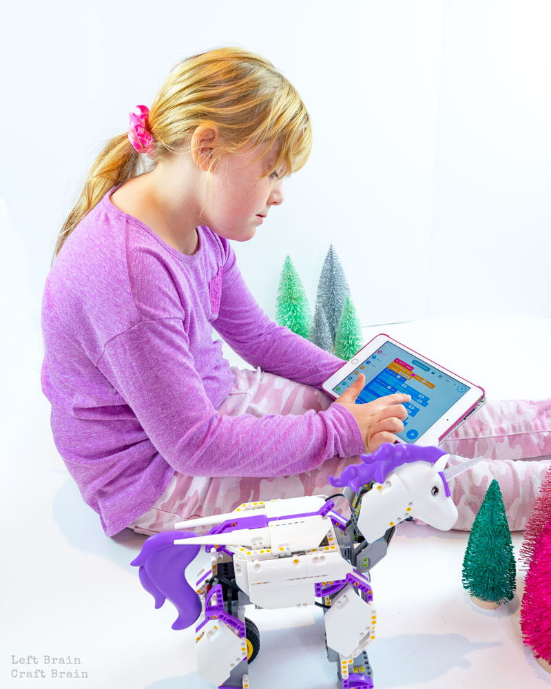 girl coding unicorn robot