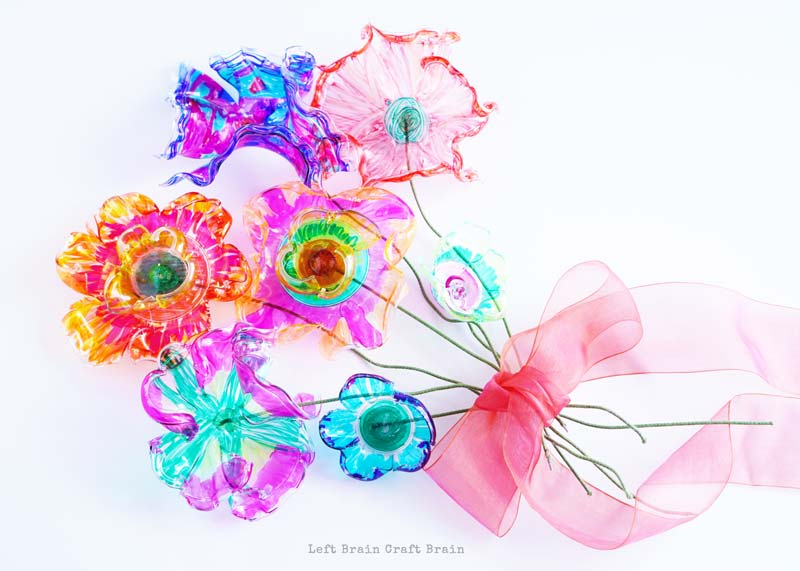 colorful recycled plastic flowers bouquet with ribbon
