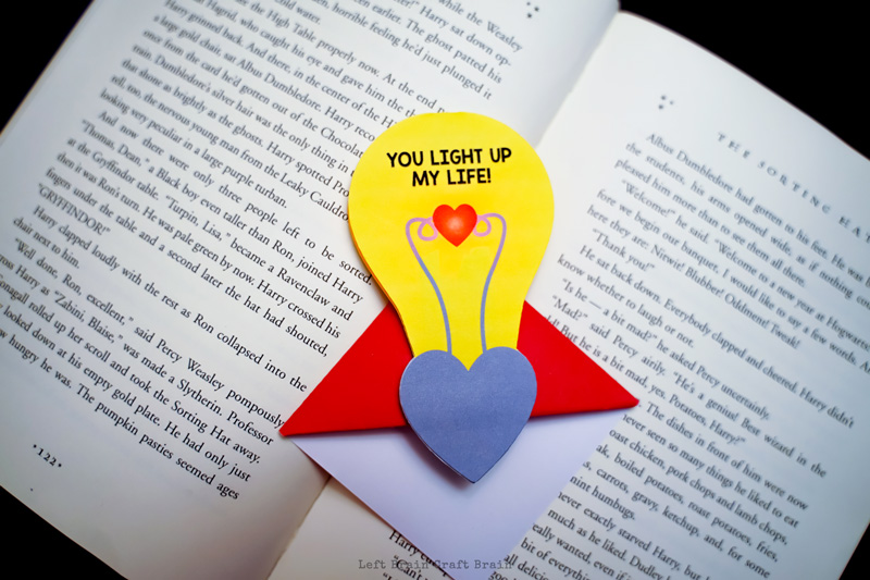 completed light up corner bookmark on open book