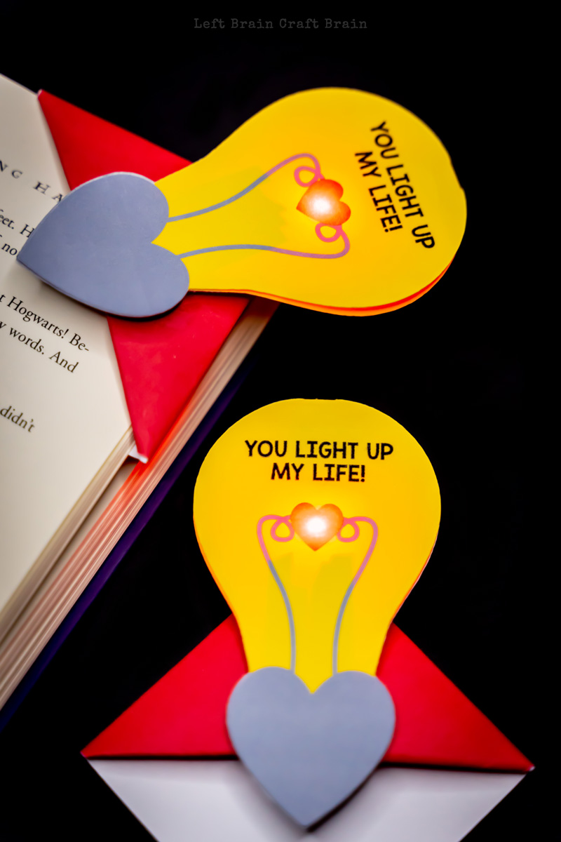 two completed light up valentine corner bookmarks on a book