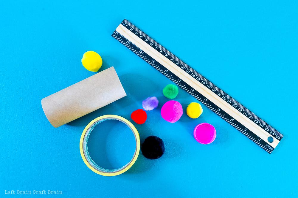 ruler tape pom poms plastic cap toilet paper roll catapult supplies