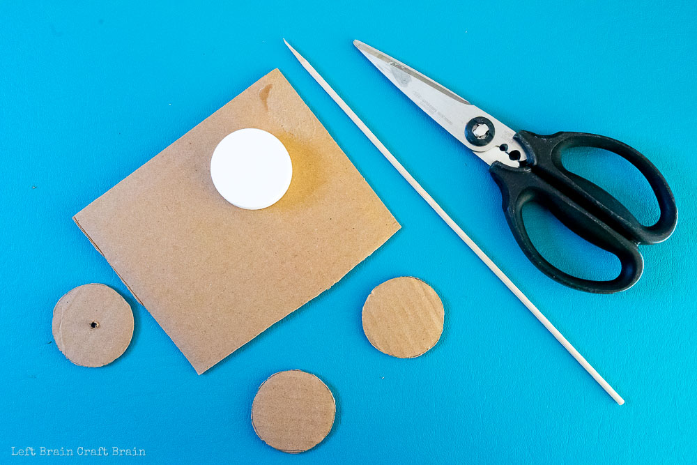cut out wheels out of cardboard and poke with a skewer