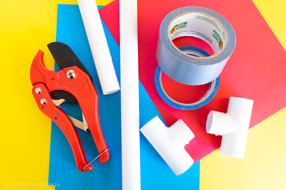 diy stomp rockets supplies: PVC pipe, PVC pipe cutter, duct tape, masking tape, PVC pipe fittings, paper